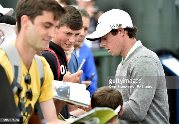 Northern Ireland's Rory McIlroy signs autographs during day three of the 2014 Open Championship at Royal Liverpool Golf Club Hoylake