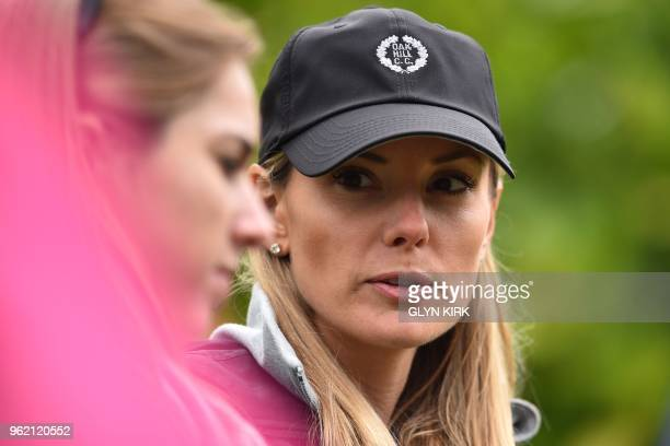 Northern Ireland's Rory McIlroy's wife Erica Stoll follows her husband during his first round 67 on the first day of the PGA Championship at...