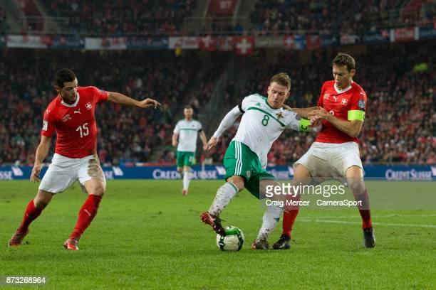 Northern Ireland's Steven Davis holds off the challenge from Switzerlands Stephan Lichtsteiner during the FIFA 2018 World Cup Qualifier PlayOff...