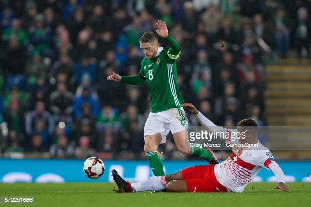 Northern Ireland's Steven Davis is tackled by Switzerlands Manuel Akanji during the FIFA 2018 World Cup Qualifier PlayOff First Leg between Northern...