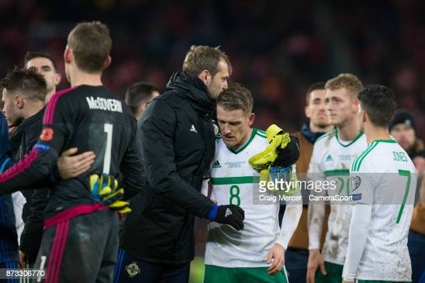 Northern Ireland's Steven Davis looks dejected and is comforted by team mate Roy Carroll after the FIFA 2018 World Cup Qualifier Play-Off: Second Leg...
