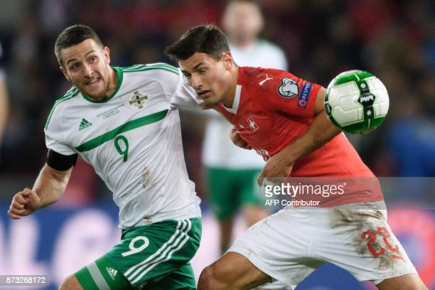 Northern Ireland's striker Conor Washington and Switzerland's defender Fabian Schar vie for the ball during the FIFA 2018 World Cup playoff second...