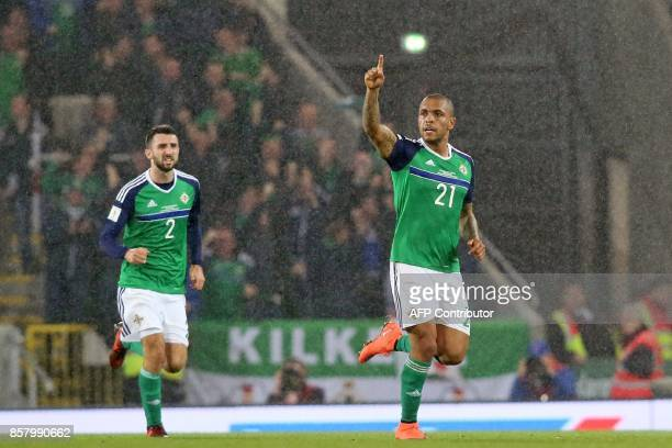 Northern Ireland's striker Josh Magennis celebrates aftre scoring their consolation goal at the end of the FIFA World Cup 2018 qualification football...