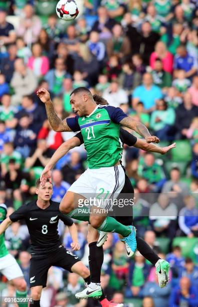Northern Ireland's striker Josh Magennis leaps for the ball during the international friendly football match between Northern Ireland and New Zealand...
