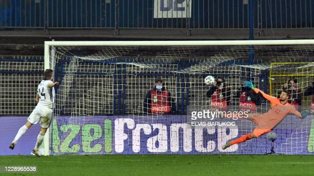 Northern Ireland's Stuart Dallas beats Bosnia and Herzegovina's goalkeeper Ibrahim Sehic during the penalties shoot-out during the UEFA Euro 2020...