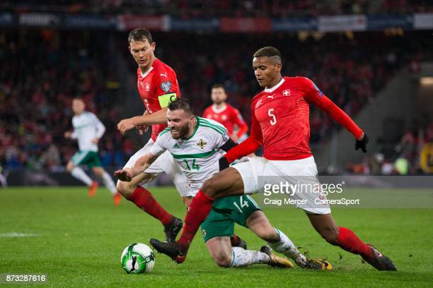 Northern Ireland's Stuart Dallas goes down under the challenge of Switzerlands Manuel Akanji during the FIFA 2018 World Cup Qualifier PlayOff Second...