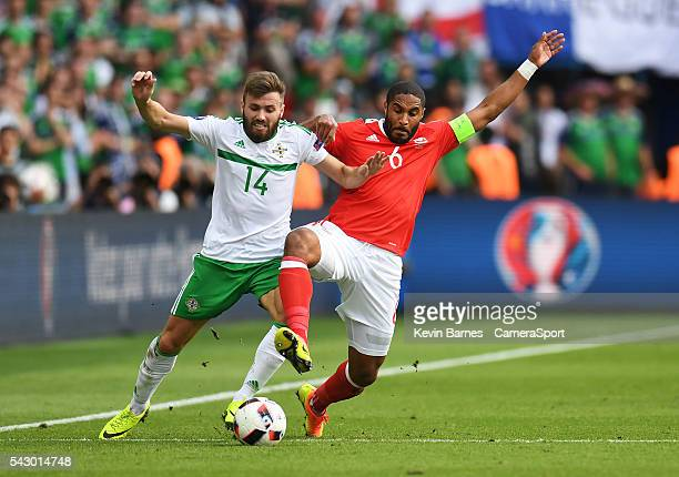 Northern Ireland's Stuart Dallas is tackled by Wales's Ashley Williams during the UEFA Euro 2016 Round of 16 match between Wales and Northern Ireland...