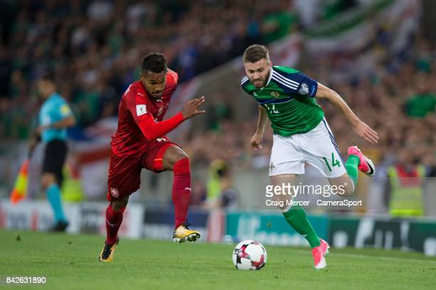 Northern Ireland's Stuart Dallas vies for possession with Czech Republic's Theodor Gebre Selassie during the FIFA 2018 World Cup Qualifier Northern...
