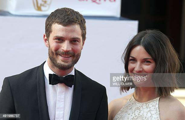 Northern Irish actor Jamie Dornan and his wife Amelia Warner pose for pictures on the red carpet upon arrival for the BAFTA TV awards in London on...