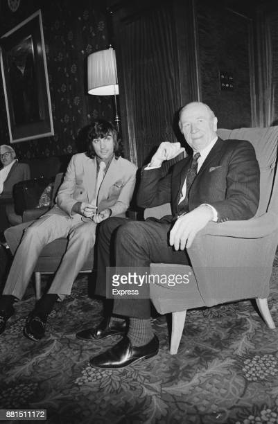 Northern Irish football player George Best of Manchester United FC with manager Matt Busby at the FA's headquarters for a disciplinary hearing...