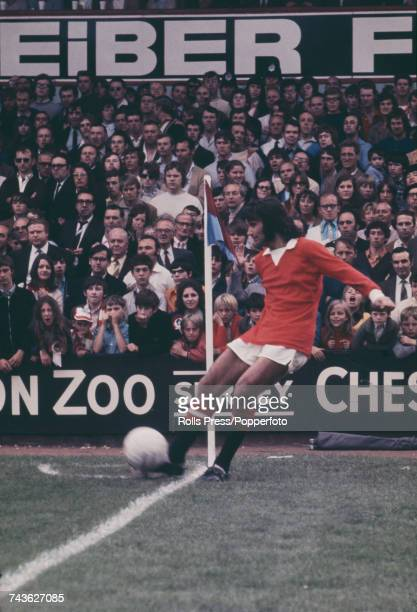 Northern Irish footballer and winger with Manchester United Football Club George Best pictured taking a corner for Manchester United in a League...