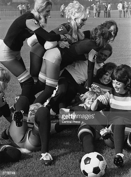 Northern Irish footballer Danny Blanchflower attempts to referee a charity football match between a team of Bunny Girls from the Playboy Club and a...