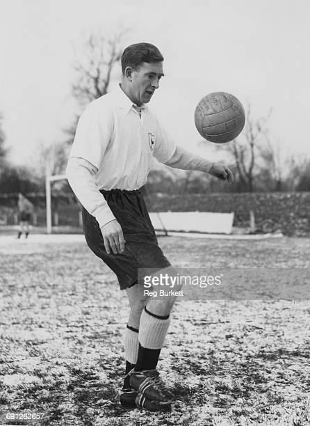 Northern Irish footballer Danny Blanchflower of Tottenham Hotspur practises ball control at Cheshunt before a fourthround cup tie match against...