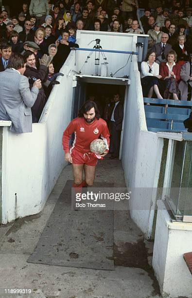 Northern Irish footballer George Best comes out of the players' tunnel to make his debut for Bournemouth against Newport County in a Division Three...