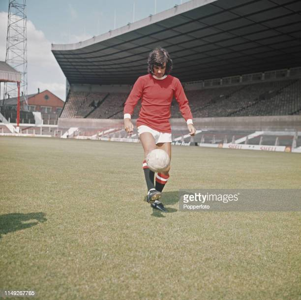 Northern Irish footballer George Best , midfielder with Manchester United, pictured on the pitch at the club's Old Trafford Stadium in Manchester in...