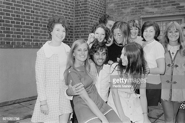 Northern Irish footballer George Best surrounded by young women, UK, 24th June 1970.