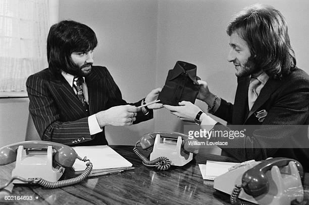 Northern Irish footballer George Best with entrepreneur Harold Tillman UK 17th January 1971 Best has been recruited to help publicise Tillman's...