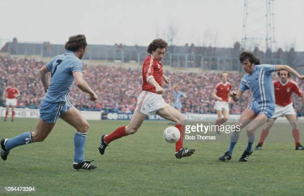 Northern Irish footballer Martin O'Neill, midfielder with Nottingham Forest Football Club, pictured in action with the ball during the League...