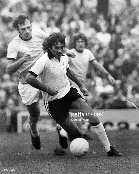 Northern Irish footballer player George Best takes the ball from Alan Warboys of Bristol Rovers during his first game for Fulham at Craven Cottage