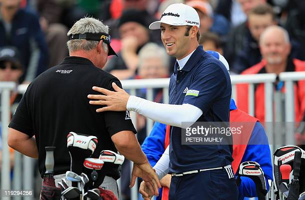 Northern Irish golfer Darren Clarke and US golfer Dustin Johnson shakes hands on the final day of the 140th British Open Golf championship at Royal...