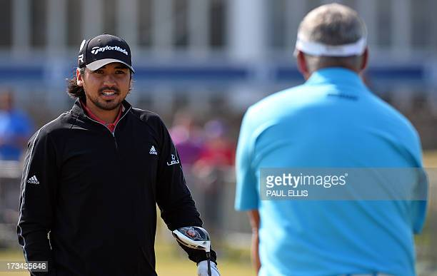 Northern Irish golfer Darren Clarke talks with Australian golfer Jason Day on the practice ground during practice for the 2013 British Open Golf...
