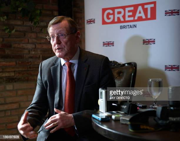 Northern Irish Nobel Peace Prize laureate Lord David Trimble gestures as he discusses efforts to negotiate a peace accord between the Philippine...