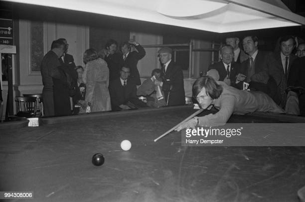 Northern Irish professional snooker player Alex Higgins pictured at play in a practice session on a snooker table prior to competing in the Norwich...