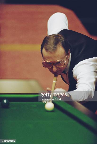 Northern Irish professional snooker player Dennis Taylor pictured in action during competition in the 1993 Embassy World Snooker Championship at the...