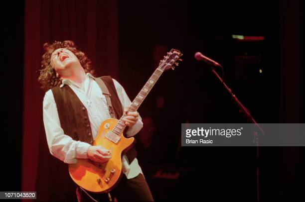 Northern Irish rock guitarist and musician Gary Moore performs live on stage at Shepherd's Bush Empire in London in April 1995