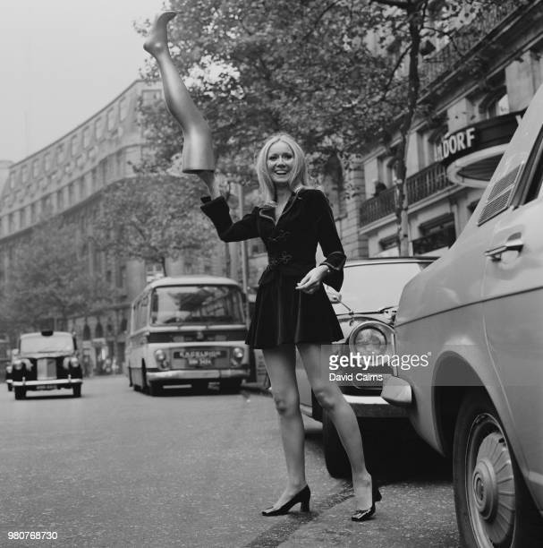 Northern Irish singer and actress Clodagh Rodgers carrying a fake leg after being elected as 'Girl with Best Legs in Show Business' Strand London UK...