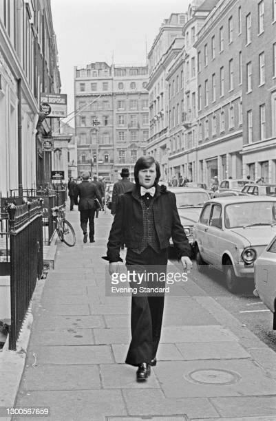 Northern Irish snooker player Alex Higgins shows off his new look, created by British fashion designer Tom Gilbey, London, UK, 24th April 1973.