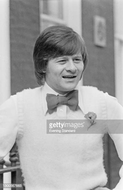 Northern Irish snooker player Alex Higgins shows off his new look, created by British fashion designer Tom Gilbey, London, UK, 17th April 1973.
