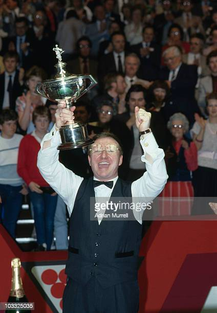 Northern Irish snooker player Dennis Taylor with the trophy after beating defending world champion Steve Davis in the World Snooker Championship...