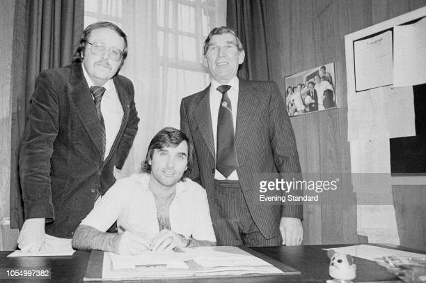 Northern Irish soccer player George Best with Hibernian FC manager Eddie Turnbull and George Royce, following his signing with the team, UK, 16th...