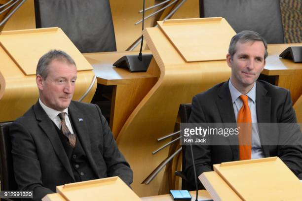 Northern Isles MSPs Tavish Scott and Liam McArthur at First Minister's Questions in the Scottish Parliament on February 1 2018 in Edinburgh Scotland...