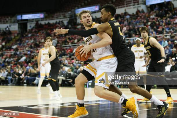 Northern Kentucky Norse forward Carson Williams looks to shoot over Milwaukee Panthers guard Jeremy Johnson during the Horizon League championship...
