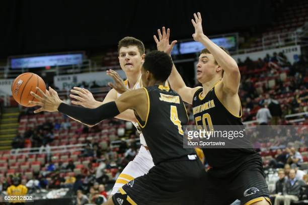 Northern Kentucky Norse forward Drew McDonald looks to pass the ball while being defended by Milwaukee Panthers guard Jeremy Johnson and Milwaukee...