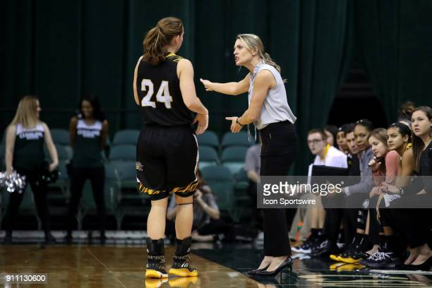 Northern Kentucky Norse head coach Camryn Whitaker instructs Northern Kentucky Norse guard Molly Glick during he third quarter of the women's college...