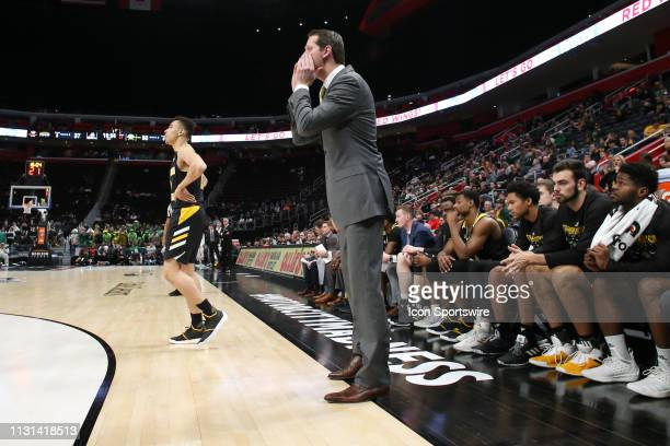 Northern Kentucky Norse head coach John Brannen shouts instructions to his players during the Horizon League Conference tournament championship game...