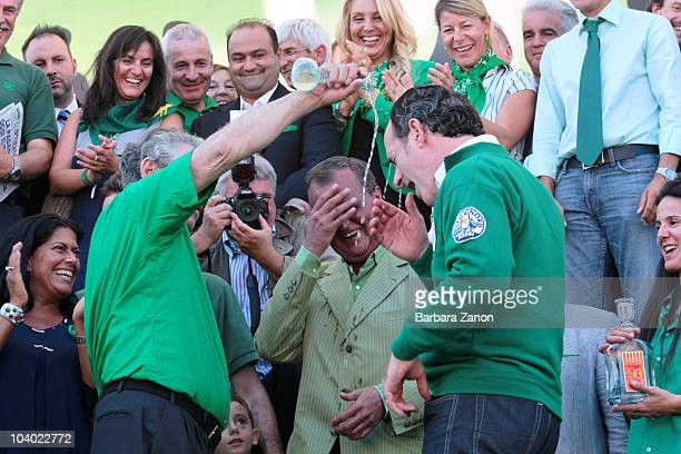 Northern League leader Umberto Bossi pours water over Luca Zaia during the Lega Nord Annual Party Rally on September 12, 2010 in Venice, Italy. The...