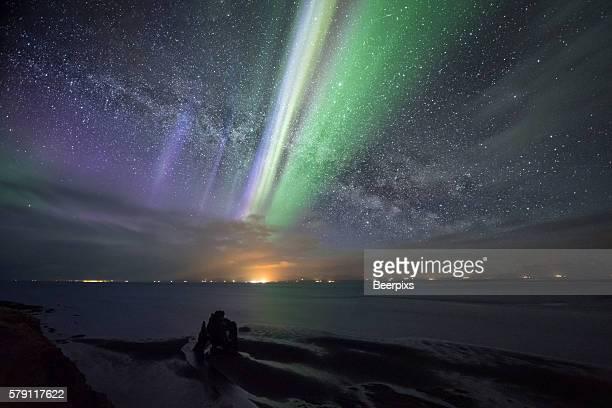 northern light and miliy way at hvitserkur, iceland. - norden stock-fotos und bilder