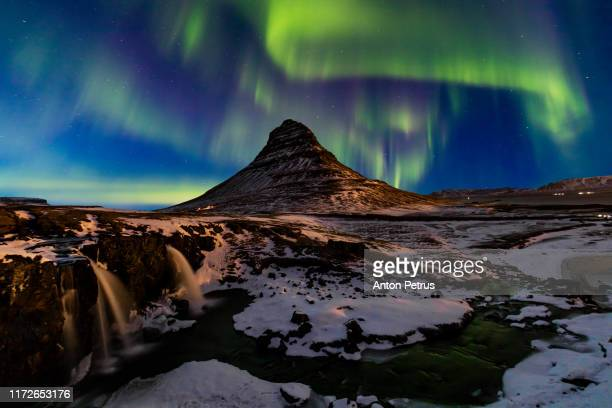 northern light, aurora borealis at kirkjufell in iceland. kirkjufell mountain in winter - tundra stock pictures, royalty-free photos & images