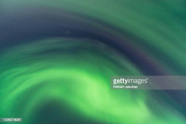 northern light (aurora borealis) phenomenon in northern iceland. - light natural phenomenon stock pictures, royalty-free photos & images