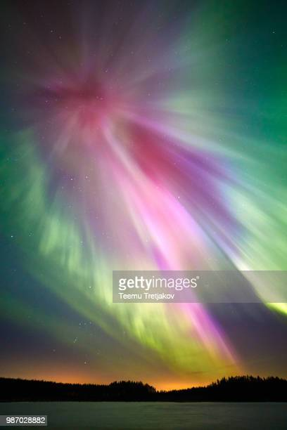 northern lights above lake - teemu tretjakov stock pictures, royalty-free photos & images