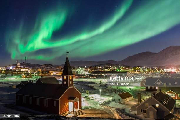 northern lights above nuuk - grönland stock-fotos und bilder