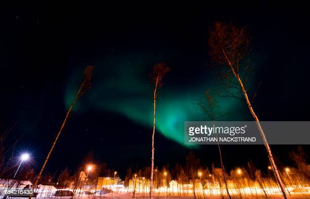 Northern Lights also known as 'aurora borealis' illuminate the night sky on March 16 2017 in Alta northern Norway / AFP PHOTO / Jonathan NACKSTRAND