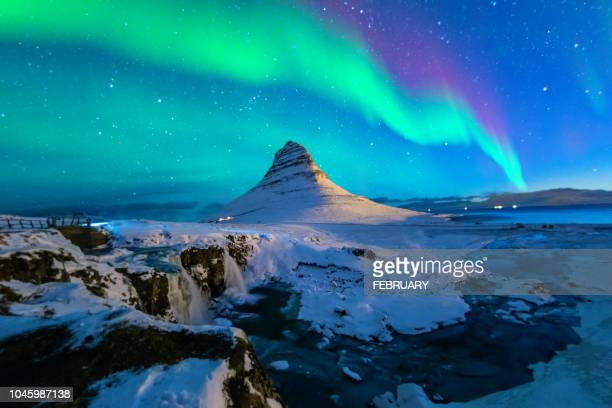 northern lights at mount kirkjufell, iceland - vulkan stock-fotos und bilder