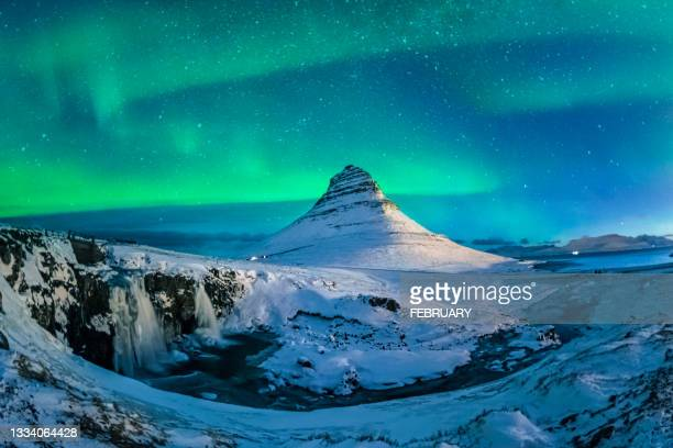 northern lights at mount kirkjufell, iceland - iceland stock pictures, royalty-free photos & images