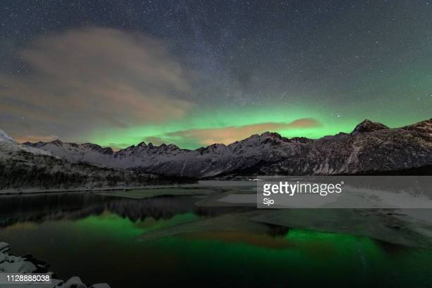 Northern Lights, Aurora Borealis over a lake in the Lofoten Islands in Northern Norway during winter