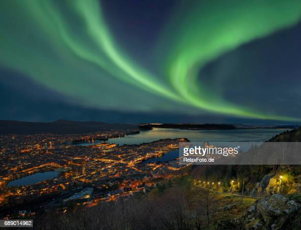 northern lights - aurora borealis over harbor of bergen city, norway - norway stock pictures, royalty-free photos & images